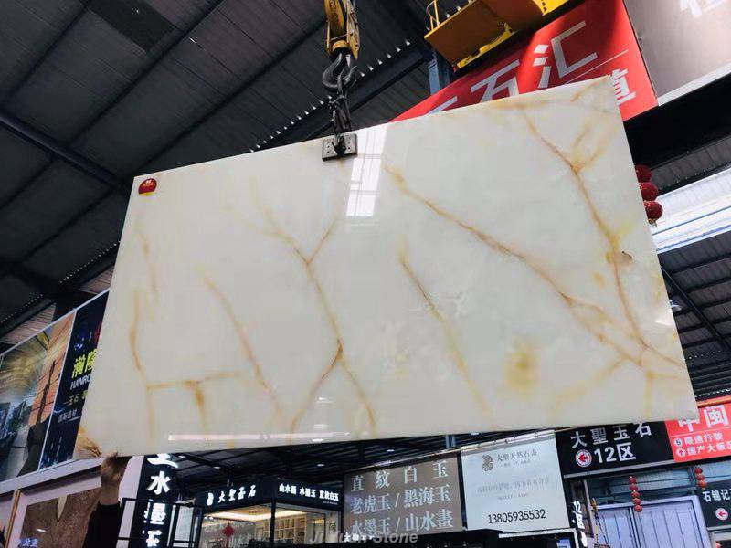 white marble flooring,onyx material,onyx stone colors,onyx shower surround,onyx stone benefits,onyx shower pan,onyx stone properties,white and grey marble