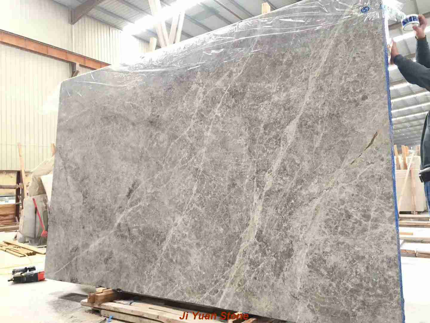 Grey marble countertops,grey marble tiles,grey marble floor,grey stone tiles,white and grey marble,grey and white marble bathrooms,white and grey countertops,grey brick tiles