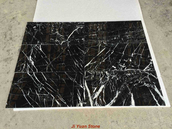 What are the precautions in the black marble granite laying process?